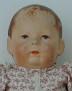 Puppe 1 im zartgeblümten Kleidchen