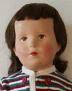 VEB-Puppe im grünen Kleid mit Strickjacke